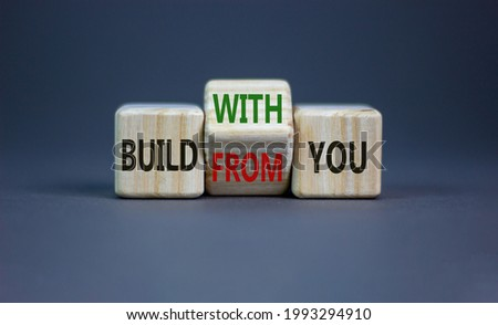 Build from or with you symbol. Turned the wooden cube and changed words 'build from you' to 'build with you'. Beautiful grey background, copy space. Business, build from or with you concept. ストックフォト ©