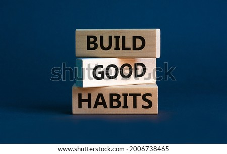 Build good habits symbol. Wooden blocks with words 'build good habits'. Beautiful grey background, copy space. Business, psychological and build good habits concept. Photo stock ©