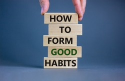 Build good habits symbol. Wooden blocks with words 'how to form good habits'. Male hand. Beautiful grey background, copy space. Business, psychological and build good habits concept.