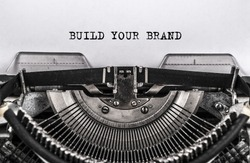 BUILD YOUR BRAND typed words on old vintage typewriter. close up