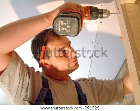 Builder at work (image contains some noise) - stock photo