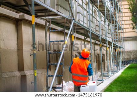 Builder concept. Builder unload truck. Builder in working uniform. Builder carry bricks. Safety comes first. #1475161970