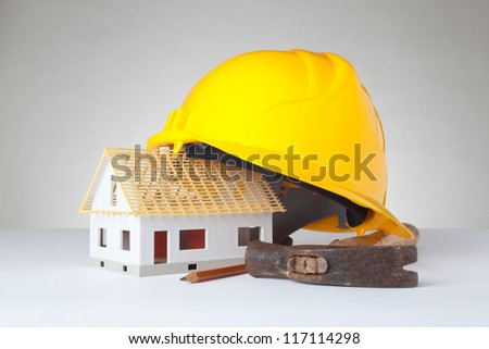 Builder equipment and model of the house - rough construction.