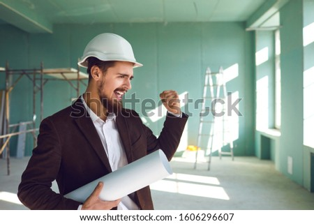 Builder foreman rejoices in a successful project at a construction