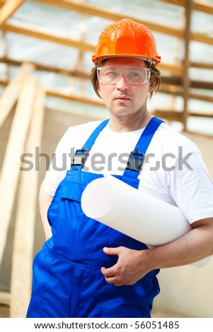 builder holding construction plan