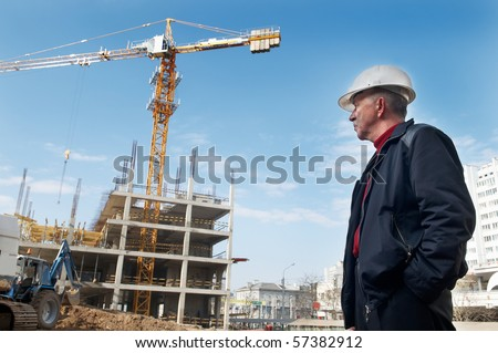 builder inspector worker checking a construction site works