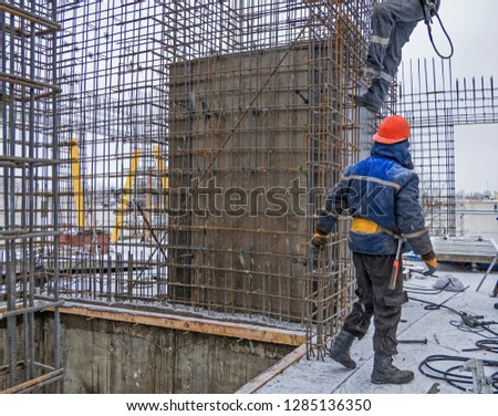 Builder installer on the Construction site #1285136350