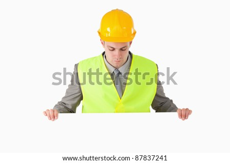 Builder looking at a blank panel against a white background