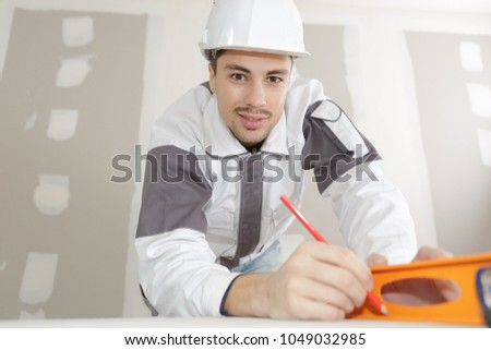 builder posing and smiling #1049032985