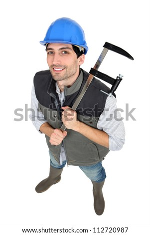 Builder with a clamp - stock photo
