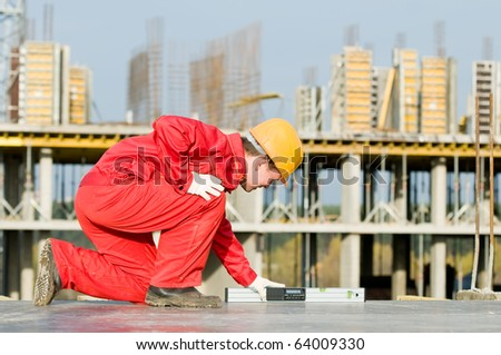 builder worker checking horizontal with digital level tool at construction site