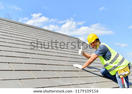 Builder Working On Roof Of New Building