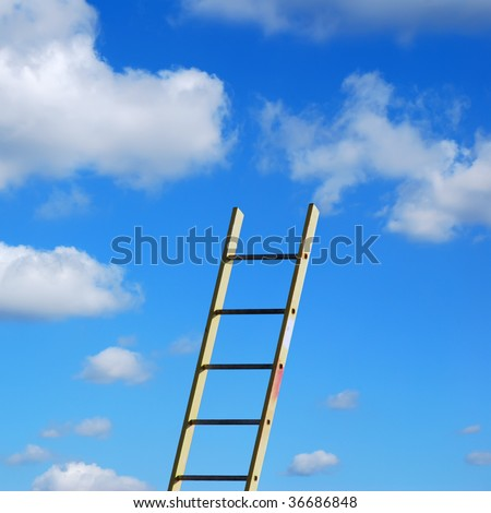 Builders step ladder against cloudy blue sky