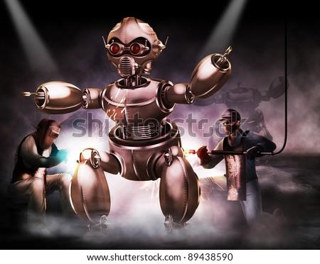 Builders working on robot