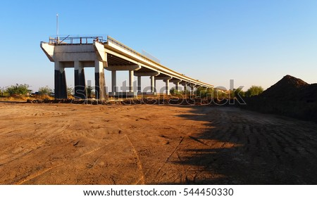 Building a bridge over a railroad stock photo