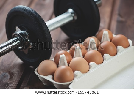 Building a muscle mass: weightlifting and protein food, horizontal shot - stock photo