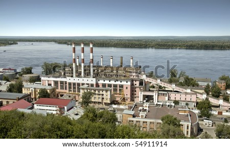 Building a power station in the city of Samara. On the bank of the Volga River. The building was built in 1930, the station was founded in 1904. Cityscape.