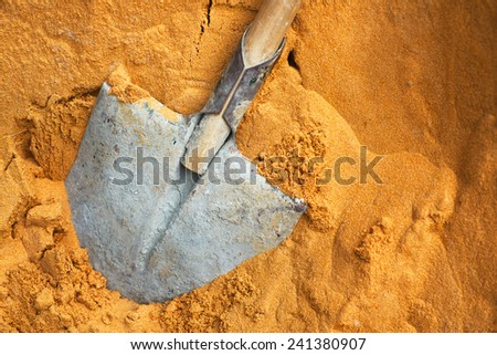 Building a shovel in sand on construction #241380907