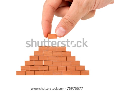 Building a small brick wall on white background #75975577