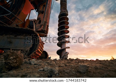 Building activity on contruction site. Close-up view of drilling machine.   Stockfoto ©
