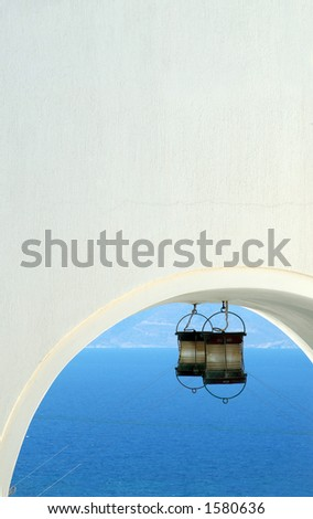 building arch with light over the sea greece