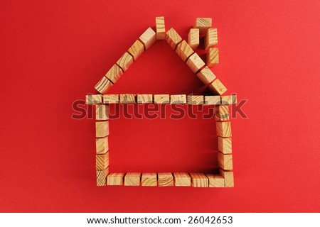 building blocks /A house symbol isolated on a red background