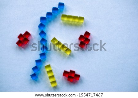 Building blocks illustrating concepts of design, construction, science, medicine, society, economy. Colorful - red, blue, yellow. #1554717467