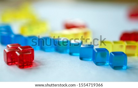 Building blocks illustrating concepts of design, construction, science, medicine, society, economy. Colorful - red, blue, yellow. #1554719366