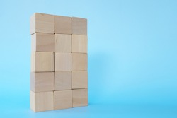 Building blocks tower in blue background with copy space. Stability, achievement and growth concept
