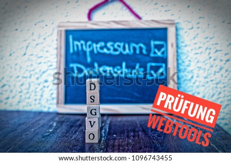 Building Blocks with the inscription DSGVO (General Data Protection Regulation) in English GDPR Imprint and Privacy and Testing Web Tools (in german Impressum Datenschutz und Prüfung Webtools #1096743455
