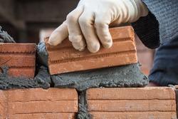Building brick block wall on construction plant