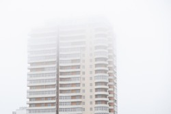 Building city fog architecture office scene skyscraper. sky