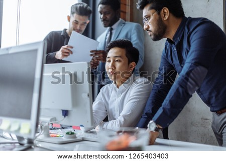 building, construction, architecture and people concept - business team of real estate company meeting and discussing new sale strategy sitting at office conference room #1265403403