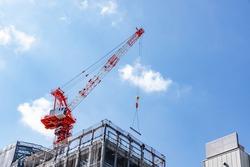 Building construction site and crane