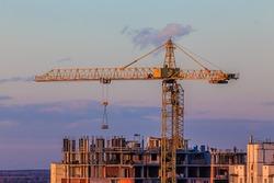 Building construction site with crane