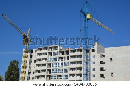 Building crane and building under construction #1484733035