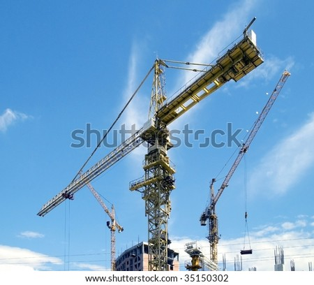 building , cranes on construction site