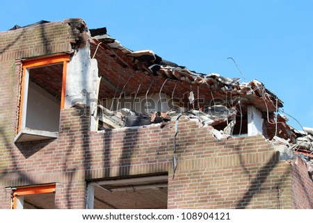 Building deconstruction - stock photo