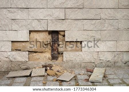 Building defect due to rising dampness on the base of a house