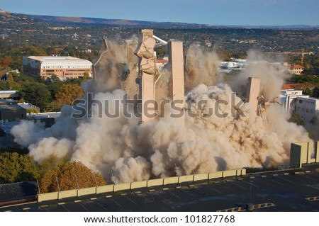 Building demolition by implosion - image 9 of a 10 shot sequence