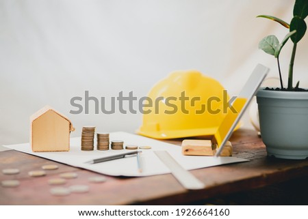 Building design concept Architectural workbench with structural drawing device The concept of uncle real estate capital, saving money to expand business capital