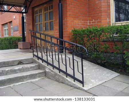 Building entrance with ramp for disabled person wheelchair for Building a wheelchair accessible home