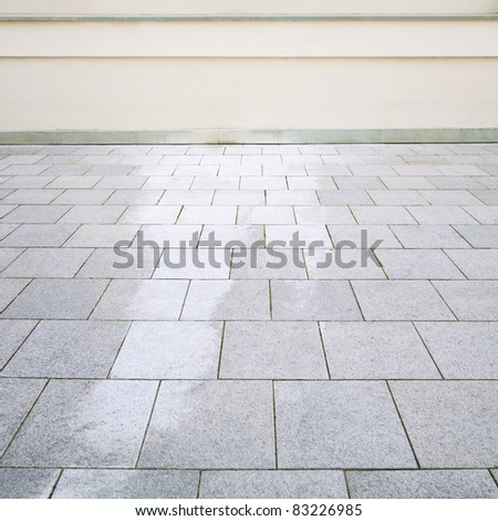 Building exterior detail. Empty wall and floor can be used as background.