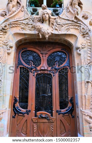 Building exteriors, doors, wrought iron, and balconies on buildings around Paris France #1500002357