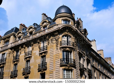 Building exteriors, doors, wrought iron, and balconies on buildings around Paris France #1500002366