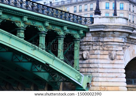 Building exteriors, doors, wrought iron, and balconies on buildings around Paris France #1500002390