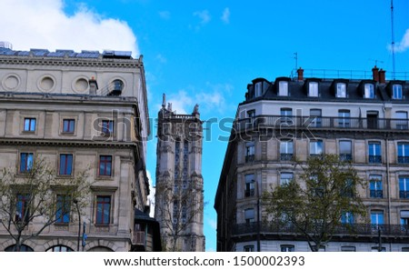 Building exteriors, doors, wrought iron, and balconies on buildings around Paris France #1500002393