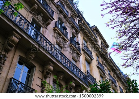 Building exteriors, doors, wrought iron, and balconies on buildings around Paris France #1500002399
