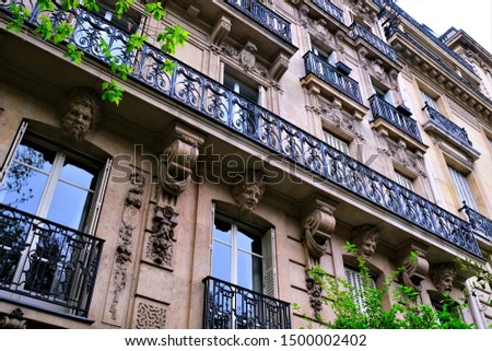 Building exteriors, doors, wrought iron, and balconies on buildings around Paris France #1500002402