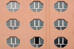 Building Facade with  Hexagonal Windows. One window is open.